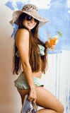 Young happy girl with cocktail and sunglasses and bikini Royalty Free Stock Photo