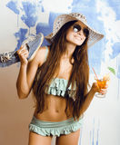 Young happy girl with cocktail and sunglasses and bikini Stock Photography