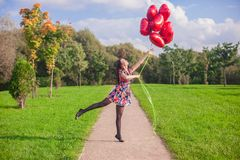 Young happy girl in colorful dress have fun with Stock Photo