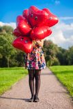 Young happy girl in colorful dress have fun with Royalty Free Stock Images