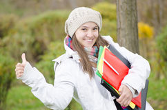 A Young Happy Girl coming from school Stock Photography