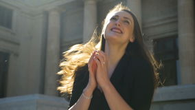 Young happy girl dancing and bouncing and jumping full of joy in the city. In slow motion stock video
