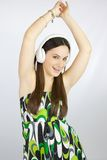 Young happy girl dancing with headphones Stock Image