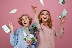 Young happy girl with delight throw up the cash. They enjoy success and prosperity, financial markets, and winning lottery stock photo