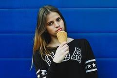 Young happy girl eating ice-cream Stock Photo