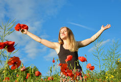 Young happy girl in field Royalty Free Stock Image