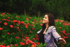 Young happy girl with flowers Stock Image