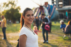 Young happy girl at the funfair royalty free stock photo