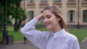 Young happy girl is going to university with tablet in hand in summer, emotional concept, studying concept.  stock video
