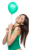 Young happy girl with green balloon Royalty Free Stock Images