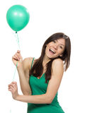 Young happy girl with green balloon Stock Image