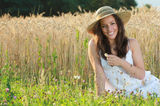 Young and happy girl with an hay hat Royalty Free Stock Photography