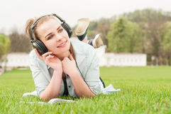 Young happy girl with headphones listening music Stock Images