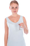 Young happy girl holding a glass of water Royalty Free Stock Photos