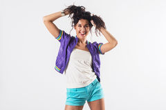 Young happy girl holding her hair, imitating tails hairstyle, wearing trendy outfit Stock Photography