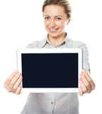 A young and happy girl holding a tablet computer Royalty Free Stock Photos