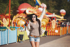 Young happy girl jumping in the park. Stock Photos