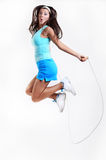 Young Happy Girl with Jumping on Rope isolated on White Royalty Free Stock Photography