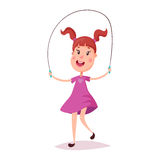 Young happy girl jumping with skipping rope Stock Images