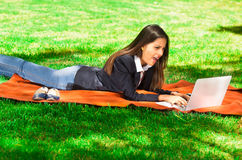 Young and happy girl with laptop in the park.  Stock Photography