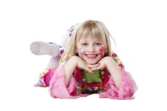 Young happy girl lies on the floor and smiles Royalty Free Stock Photography