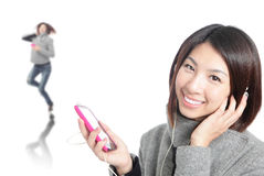 Young Happy Girl listen music with earphones Royalty Free Stock Photo