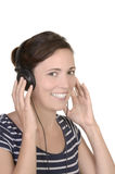 Young happy girl listens to music with headphones Stock Image