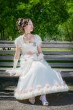 Young happy girl in a long white bride dress with a smile is rea Royalty Free Stock Photography