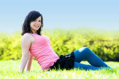 Young happy girl lying on grass Stock Photo