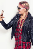 Young happy girl with mobile phone. Stock Images