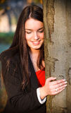 Young happy girl near a big tree. Royalty Free Stock Images