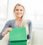 Young and happy girl opening a green present box Stock Images