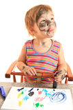 Young happy girl paint on paper. royalty free stock photo