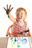 Young happy girl paint on paper. Royalty Free Stock Images