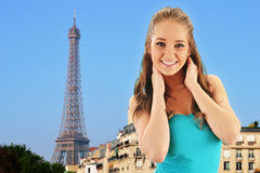Young happy girl in Paris over Eiffel Tower Stock Photo