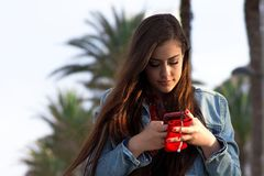 Young happy girl with the phone Stock Images