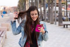 Young happy girl with the phone Stock Photography