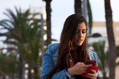 Young happy girl with the phone Royalty Free Stock Images