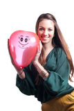 Young happy girl with red air balloon on white Royalty Free Stock Photography