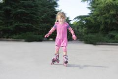 Young happy girl riding roller blades Stock Image