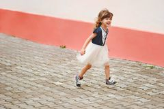 Young happy girl running away Royalty Free Stock Photography