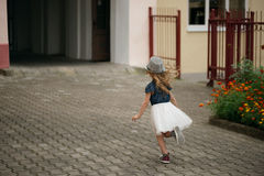 Young happy girl running away royalty free stock photo