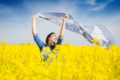 Young happy girl with a scarf in the field Stock Photo