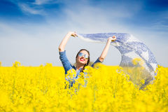 Young happy girl with a scarf in the field Royalty Free Stock Photo