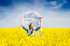 Young happy girl with a scarf in the field Royalty Free Stock Photos