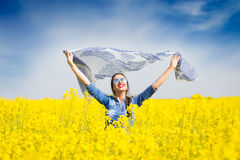 Young happy girl with a scarf in the field Stock Images