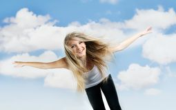Young happy girl on sky background Stock Photos