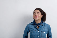 Young happy girl smiling with her eyes closed. Fashionable woman with a bandana around his neck Royalty Free Stock Photo