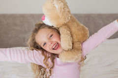 Young happy girl with stuffed toy Royalty Free Stock Image