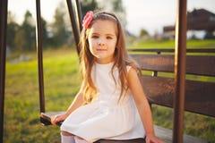 Young happy girl on the swings Stock Image